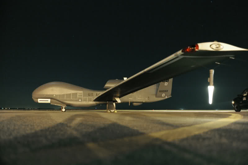 An RQ-4 Global Hawk sits on the runway before beginning a nighttime mission. The aircraft is unmanned, and is used to capture imagery from high altitudes. (Courtesy photo/John Schwab)